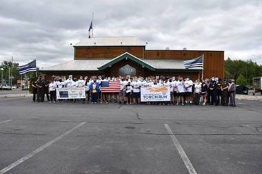 Forest Rangers and others pose for photo at Torch run