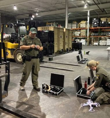 Two Rangers work on getting drones ready for UAS training