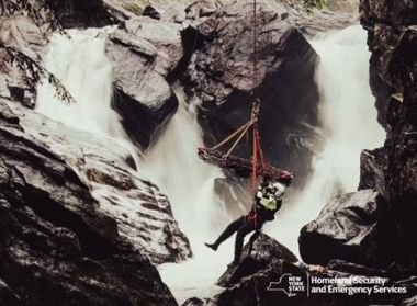 Emergency response personnel training near a waterfall