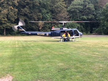 Forest Rangers loading hiker into helicopter