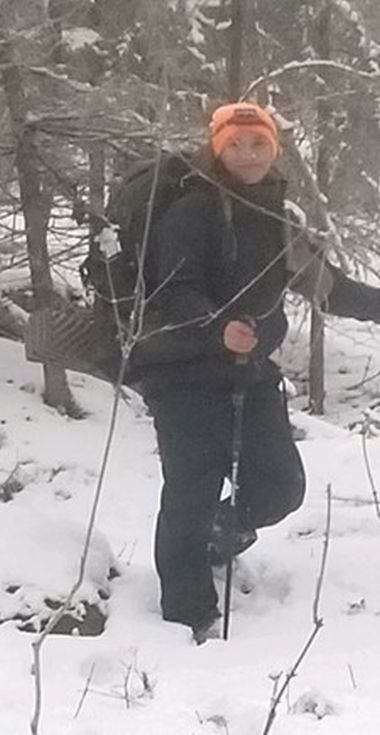 Forest Ranger in the snowy woods poses for a picture