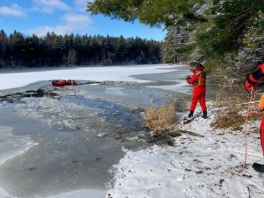Forest Rangers stand at edge of icy pond during training