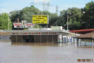 jumpin jacks drive in building surrounded by water coming half way up the windows