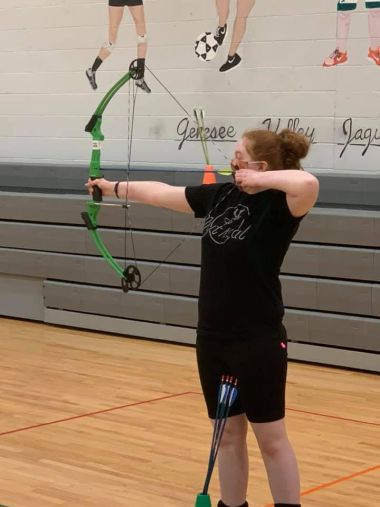 young archer readies their bow