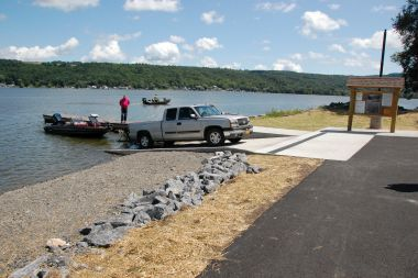A truck utilizes the boat launch to get a small boat in the water