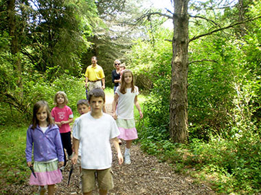 Hikers on trail at Rogers Environmental Education Center
