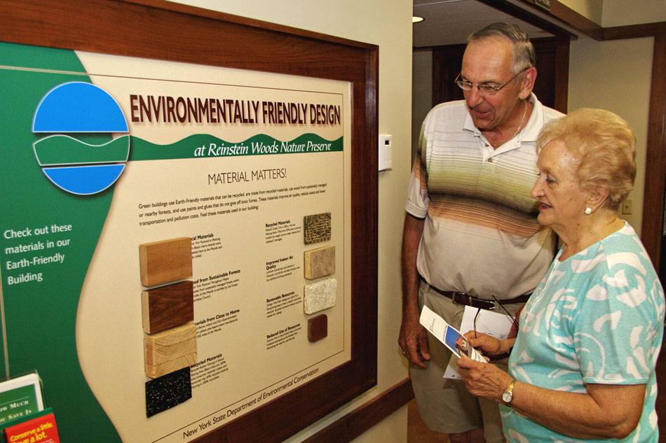 Visitors look at the sign describing the green building materials used to construct the Education Center