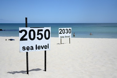 Image from Flickr/JulieG - signs showing sea level rise