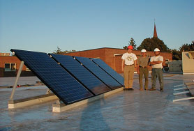 solar panels and three men on a roof