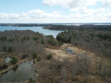 aerial view of land parcel with water in the distance