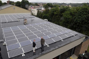 Aerial view of rooftop with solar array with the Mayor and Jim Yienger