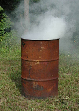 Smoldering burn barrels release dangerous toxins into the air