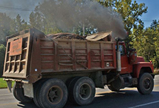 Dump truck emitting dark exhaust