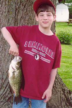 Young man holding black crappie caught in Canadace Lake
