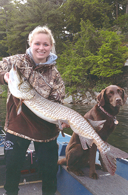 Girl with tiger musky from Hyde Lake.