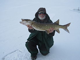 Man holding tiger musky from Lake Durant.