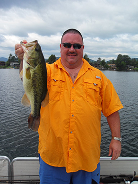 Man holding a largemouth bass from Lake George