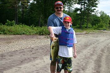 Man and sone with a big largemouth bass from Schroon Lake