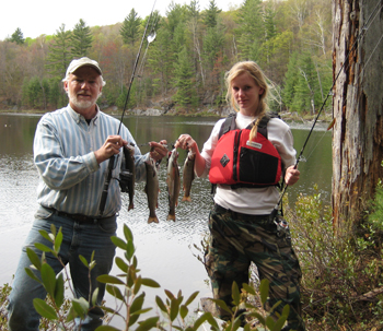 Father and daughter holding 4 nice brook trout.