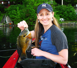 Woman holding 10 inch bluegill from Snyders Lake