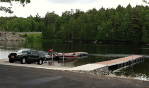 Person unloading boat at the boat launch
