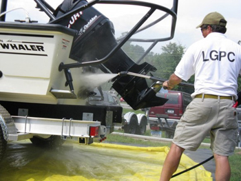 Man power washing a boat.