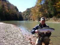 Angler holding steelhead caught from Cattaraugus Creek in Zoar Valley.