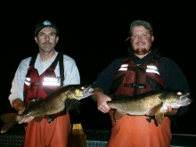 Fisheries technicians holding Chautauqua Lake walleye collected during survey.