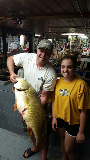 Amelia Whalen with her 29 lb. 14 oz. state record freshwater drum