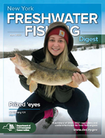 Cover of the fishing guide with a young angler holding a big fish