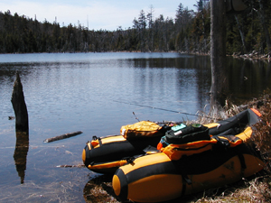 Float tube on the shore of an Adirondack Pond