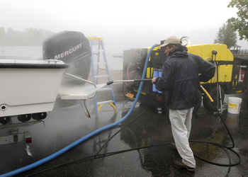 Image of pressure washing a boat.