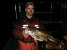 Technician holding largemouth bass captured during Lime Lake survey.