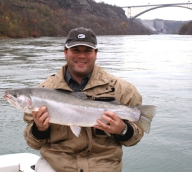 Angler holding Lower Niagara River steelhead.