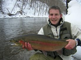 Photo of angler with large winter steelhead