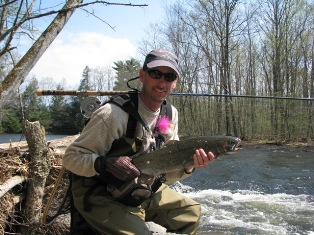A fisherman holding a Steelhead.