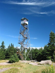 A fire tower on a mountain summit