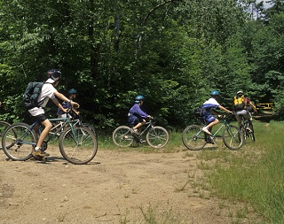 group of kids starting a bike ride on a trail