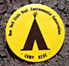 yellow and black camp here marker