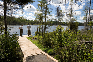 Two people standing on the edge of Helldiver Pond