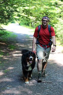 man with dog hiking in Windham - Blackhead Range Wild Forest
