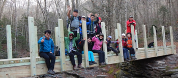 hikers enjoy the nearly complete bridge