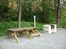 Photo of an accessible picnic table and fireplace