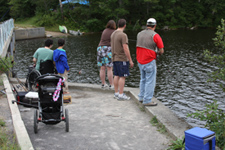 Family fishing at the Cedar River flow dam
