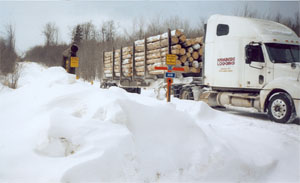 Image of truck hauling logs on Geitner Forest Road