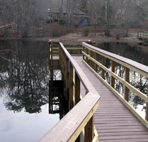 Wooden pier stretching out into Randall Pond