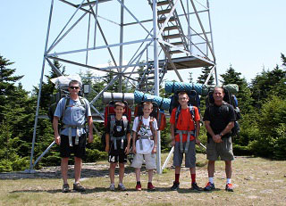 Backpacking group at the base of the Hunter Mountain Fire Tower