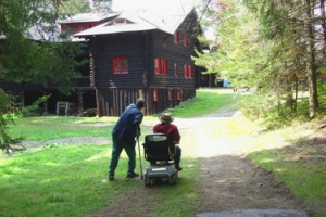 Two people on a path looking at the Main Lodge