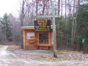 a interpretation kiosk and the DEC sign at the trailhead