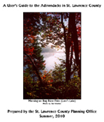 "The ""User's Guide to the Adirondacks in St. Lawrence County"" front cover, featuring the colorful photo, Morning on Bog River Flow (Low's Lake)"